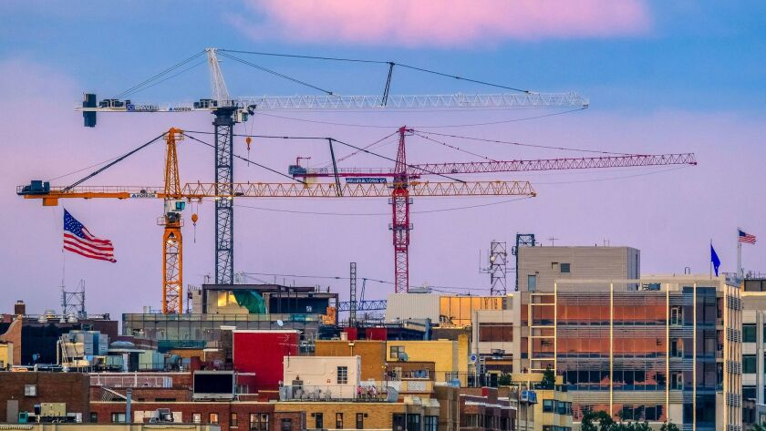 In this Saturday, July 8, 2017, photo, construction cranes loom over the Georgetown neighborhood in