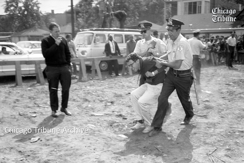Chicago police officers carry protester Bernie Sanders, 21, in August 1963 to a police wagon from a civil rights demonstration at West 73rd Street and South Lowe Avenue. He was arrested, charged with resisting arrest, found guilty and fined $25. He was a University of Chicago student at the time.