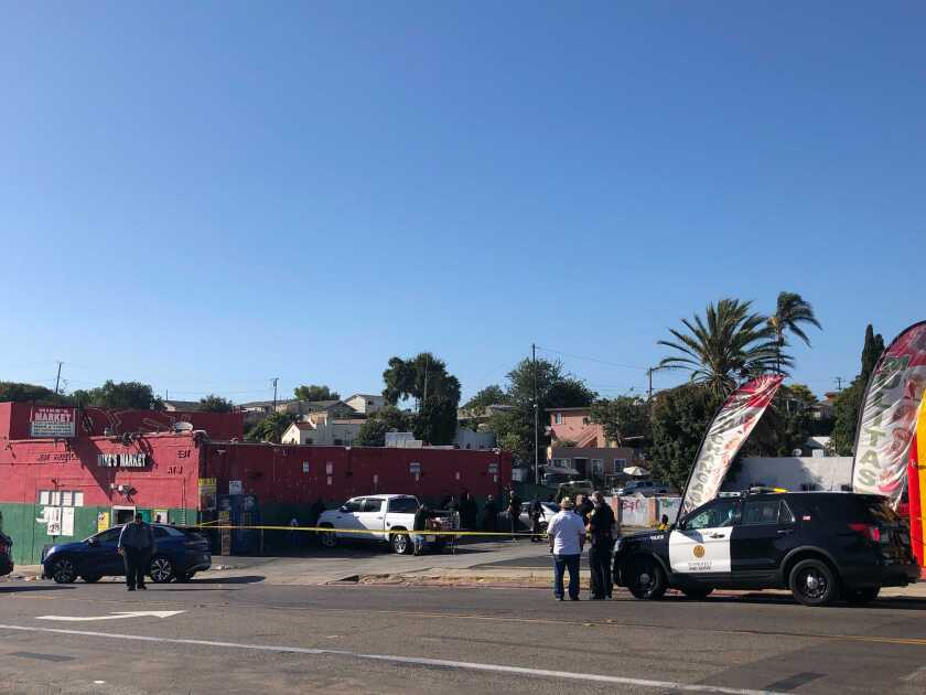 San Diego police investigate after 2 people were shot, one fatally, Monday afternoon outside Mike's Market in Mountain View.