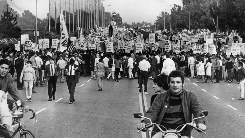 Protesters fill Motor Avenue as they march toward Century Plaza Hotel for a Vietnam War protest. This photo appeared in the Los Angeles Times on June 24, 1967.
