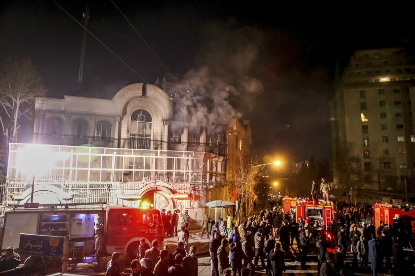 Smoke rises as Iranian protesters set fire to the Saudi embassy in Tehran.
