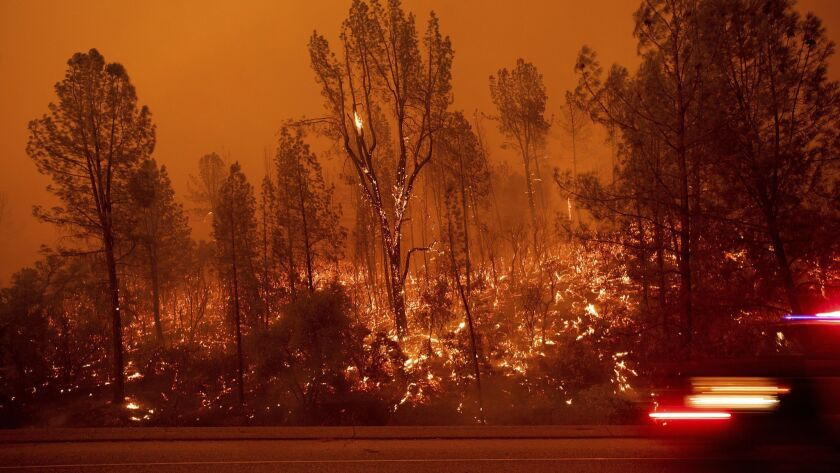 The Carr fire burns along Highway 299 in Shasta, Calif., on July 26.