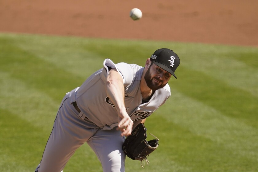 Chicago White Sox's Lucas Giolito pitches against the Oakland Athletics during the first inning of Game 1 of an American League wild-card baseball series Tuesday, Sept. 29, 2020, in Oakland, Calif. (AP Photo/Eric Risberg)