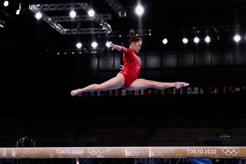 Suni Lee competes on the balance beam during the Tokyo Olympics.