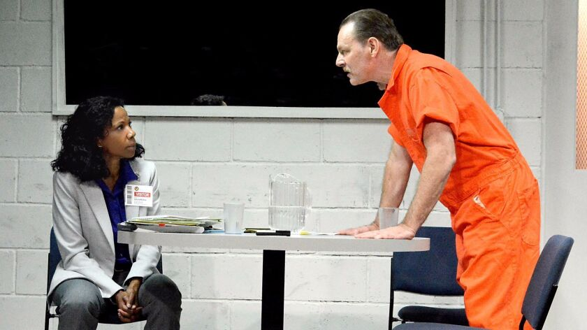 """Judith Moreland and Bo Foxworth in """"Building the Wall,"""" Robert Schenkkan's play set in a near future"""