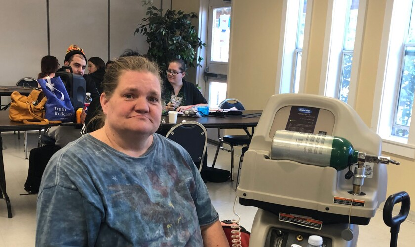 Liz Taft walked a half-mile pushing her brother-in-law's oxygen machine to recharge it for him at a senior center after PG&E cut power in Lake County.