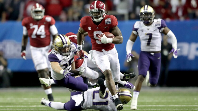 Alabama running back Bo Scarbrough breaks into the Washington secondary for a big gain during the Peach Bowl on Dec. 31.