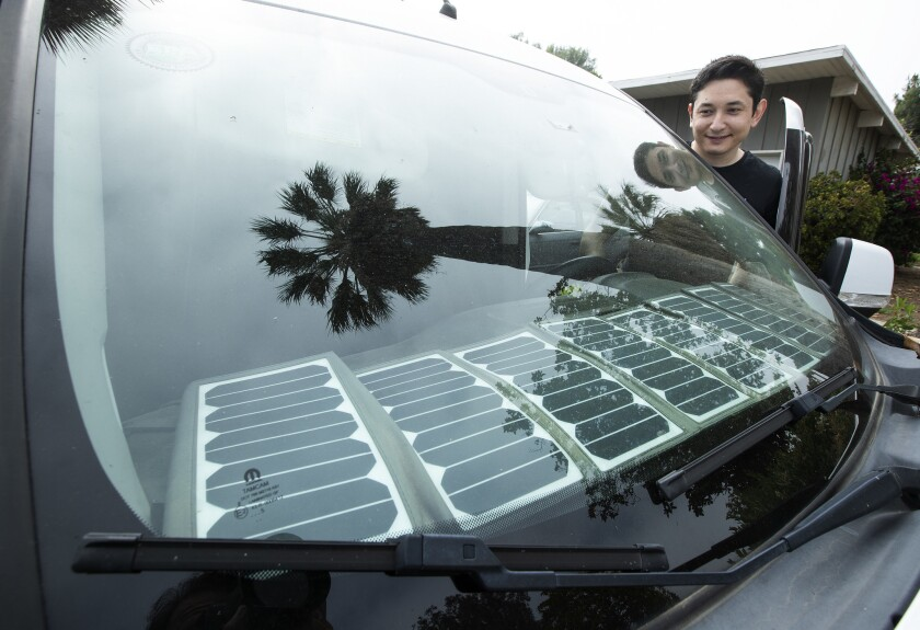 RESEDA, CA-JUNE 5, 2019: Yunus Rajabiy is photographed next to solar panels that he used to charge