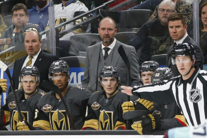 Vegas Golden Knights coach Peter DeBoer watches during the third period of the team's NHL hockey game against the Seattle Kraken on Tuesday, Oct. 12, 2021, in Las Vegas. (AP Photo/Chase Stevens)
