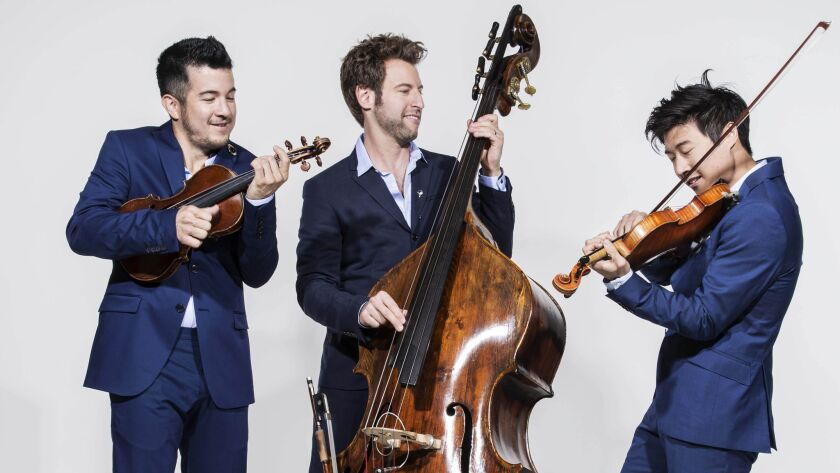 Time for Three: Nicolas (Nick) Kendall, violin;Ranaan Meyer, double bass; and Charles Yang violin. The trio will perform at the benefit concert for Classics 4 Kids, Sunday, April 9.