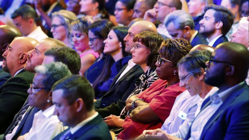 Members of the audience listen to a Democratic primary debate hosted by NBC News at the Adrienne Ars