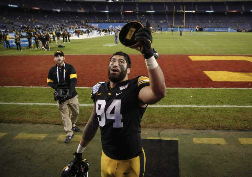 Iowa defensive end A.J. Epenesa greets his family after helping the team to a 49-24 win over Southern California during the Holiday Bowl NCAA college football game Friday, Dec. 27, 2019, in San Diego. (Bryon Houlgrave/The Des Moines Register via AP)