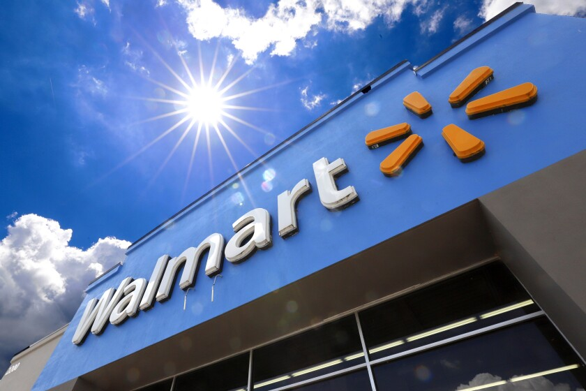 FILE - This June 25, 2019, file photo shows the entrance to a Walmart in Pittsburgh. Walmart is spreading out its traditional one-day Black Friday deals over three weekends in November 2020 in an effort to reduce crowds in its stores amid the coronavirus pandemic. (AP Photo/Gene J. Puskar, File)