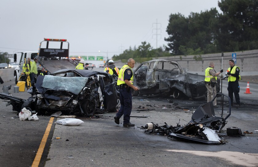 Investigators examine the scene of a deadly crash in April 2015 on U.S. Route 50 in Sacramento. Fatal crashes increased 20% in California during the first half of this year and 14% nationwide.