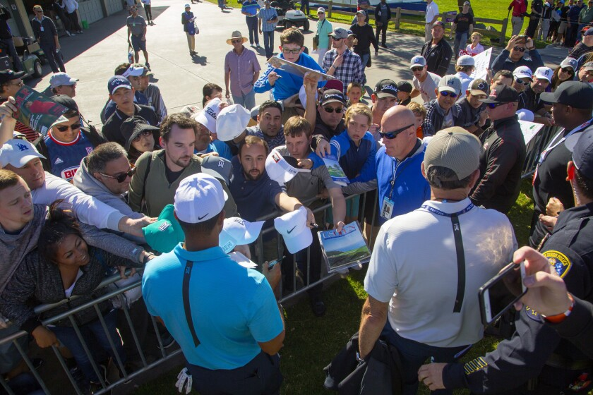 Tiger Woods signs autographs at Torrey Pines.