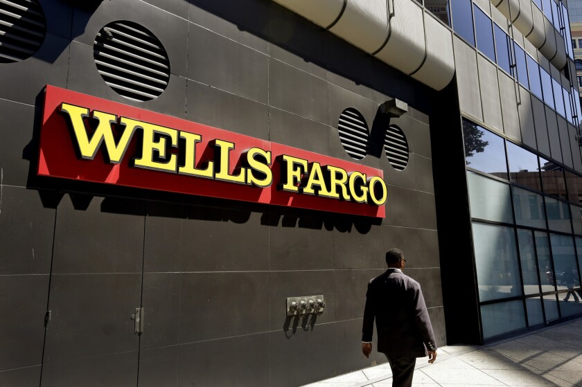 A former branch manager for a Wells Fargo in Glendale said he helped scammers access fraudulent bank accounts as part of a $14-million money laundering scheme.