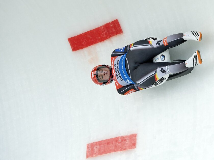 Natalie Geisenberger of Germany competes during the women's  luge World Cup race in Altenberg, eastern Germany, Sunday, Feb. 14, 2016. She leads the total World Cup standings. (AP Photo/Jens Meyer)