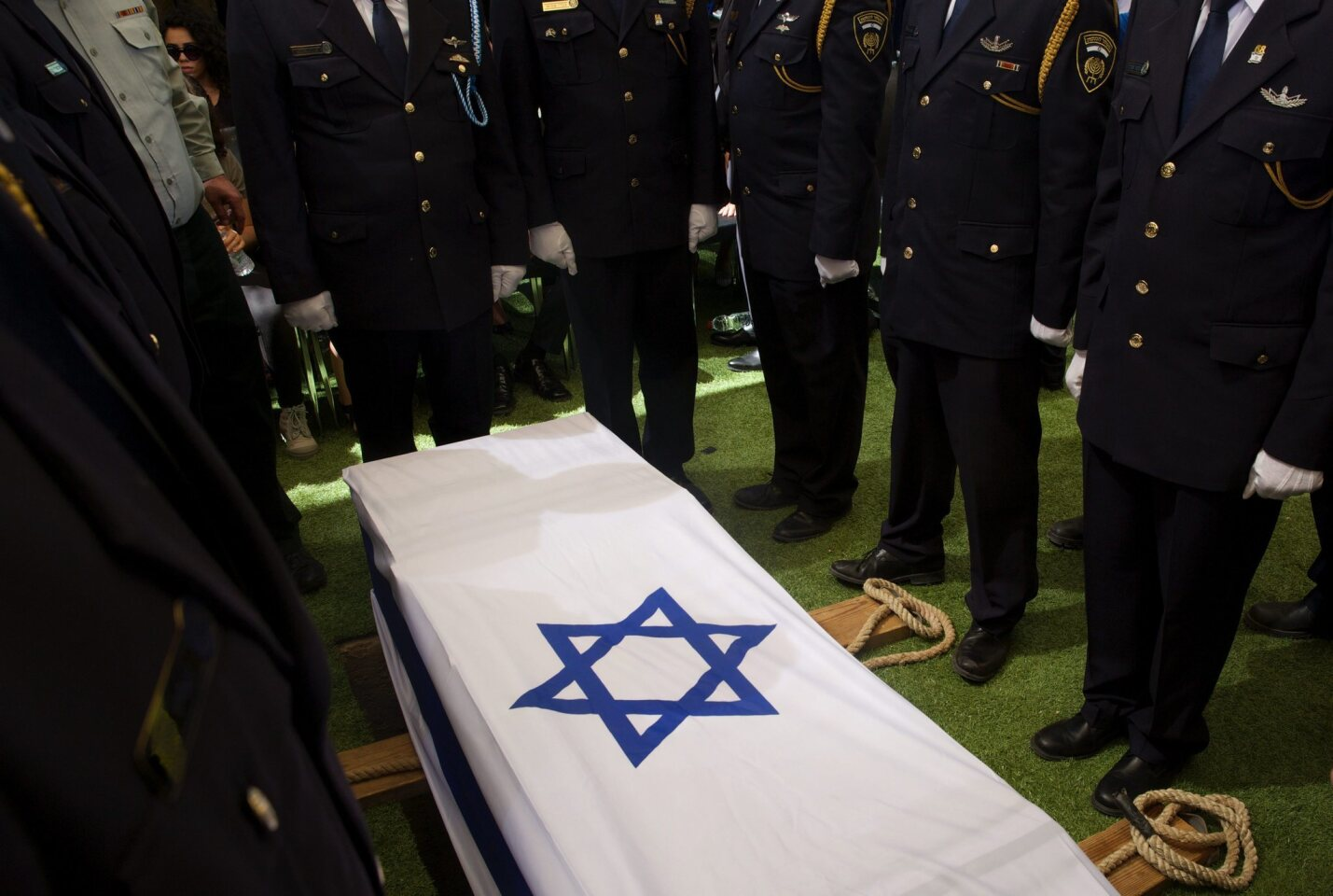 Members of an Israeli Knesset guard stand at attention around the flag-draped coffin of former Israeli President and Nobel Peace Prize winner Shimon Peres at his funeral on Sept. 30, 2016, in Jerusalem.