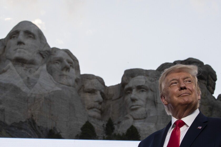 President Trump with Mt. Rushmore in the background.