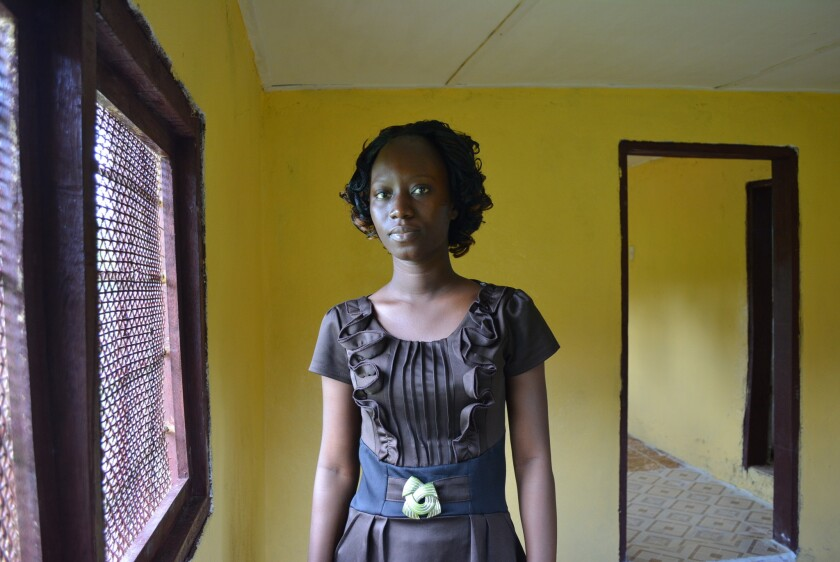 Liberian student nurse Fatu Kekula, shown on Oct. 5, saved her father's life in this makeshift isolation ward in a spare, unfinished room at home, using nothing more than raincoats and boots, plastic bags, gloves and masks.
