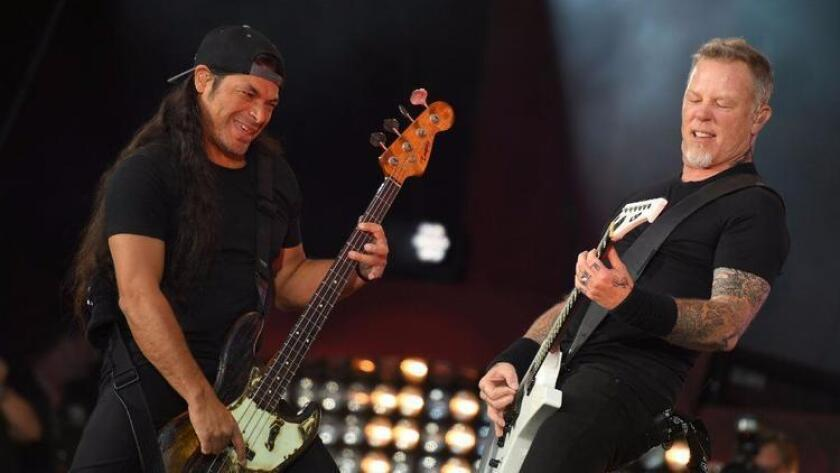 Robert Trujillo (left) and James Hetfield of Metallica perform at the 2016 Global Citizen Festival in New York's Central Park. (Photo by Angela Weissangela /AFP/Getty Images)