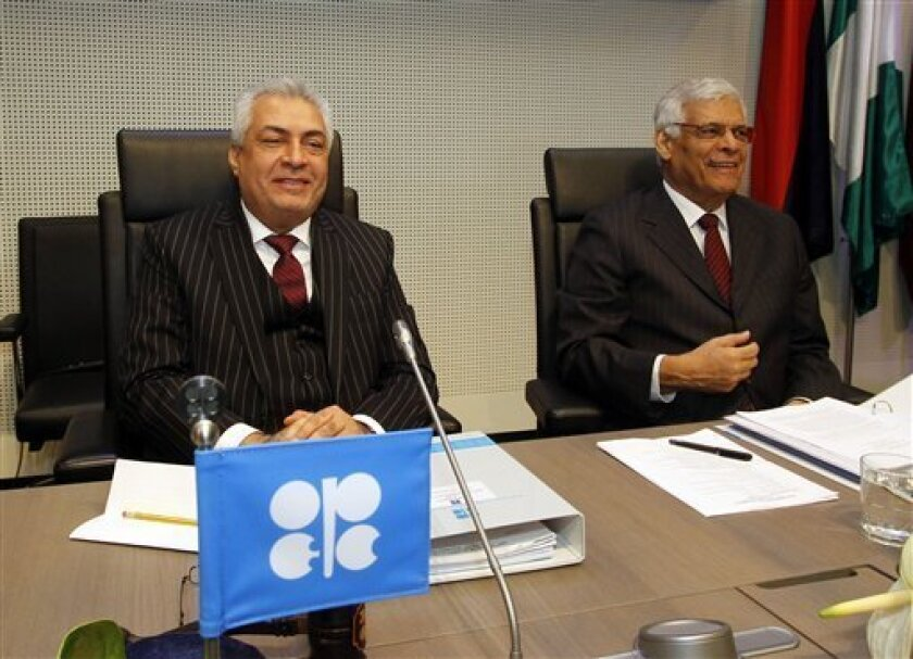Iraq's Minister of oil and President of the Conference Abdul-Kareem Luaibi Bahedh. left. and the Secretary General of OPEC Abdalla Salem El-Badri of Libya, speak to journalists prior to the start of the meeting of the Organization of the Petroleum Exporting Countries, OPEC, at their headquarters in Vienna, Austria, Wednesday, Dec. 12, 2012 . (AP Photo/Ronald Zak)