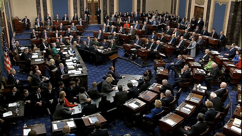 Senators vote on the first article of impeachment in the trial against President Trump.