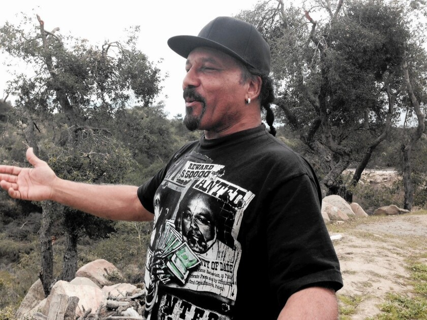 Ron Magee admires his five-acre property in the hills above Murrieta, which he may lose after being laid off from his good-paying aerospace job of 34 years.