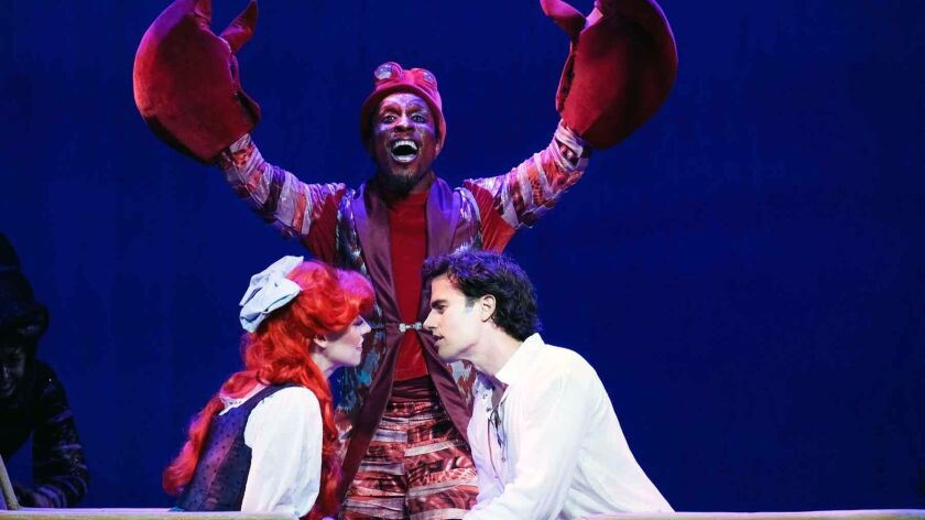 "Sebastian (Broadway veteran Cornelius Jones, Jr.) singing ""Kiss the Girl"" while Ariel (Chassey Benne"