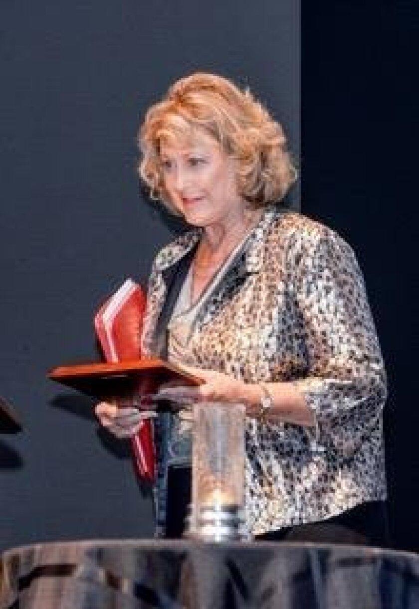 Dr. Sara Frampton receiving the Winston S. Churchill Hero Award.