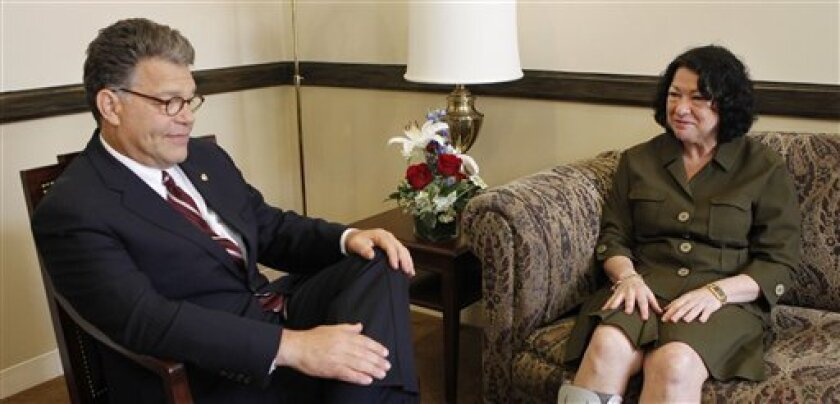 Supreme Court nominee Sonia Sotomayor, right, meets with Sen. Al Franken, D-Minn., left, on Capitol Hill in Washington, Thursday, July 9, 2009. (AP Photo/Pablo Martinez Monsivais)
