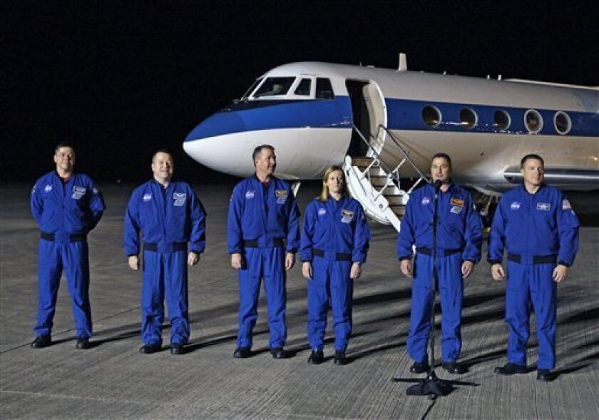 Astronauts of space shuttle Endeavour, from left, mission specialist's Bob Behnken, Nicholas Patrick, Steve Robinson, Kay Hire, commander George Zamka and pilot Terry Virts, arrive at the Kennedy Space Center in Cape Canaveral, Fla., Tuesday, Feb. 2, 2010, to prepare for their upcoming launch. Endeavour is scheduled for an early morning liftoff on Feb. 7. (AP Photo/John Raoux)