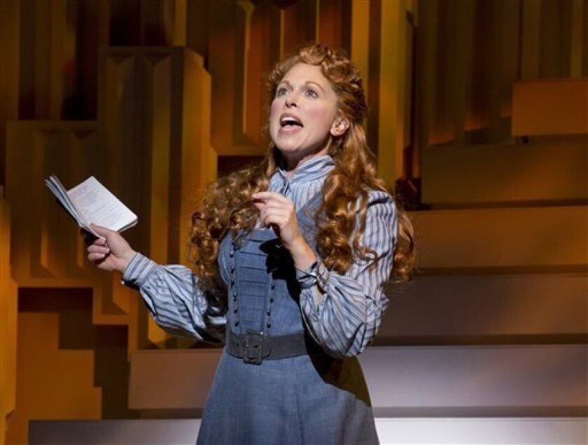 """FILE - This undated theater image released by The Publicity Office shows Carolee Carmello during a performance of the musical """"Scandalous: The Life and Trials of Aimee Semple McPherson,"""" in New York. Carmello was nominated for a Tony Award for best leading actress in a musical. (AP Photo/The Publicity Office, Jeremy Daniel, file)"""