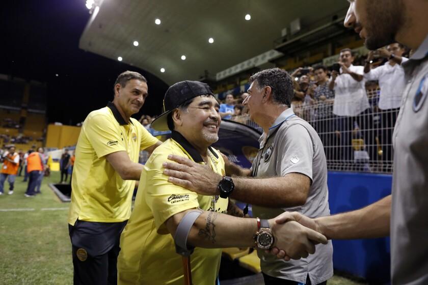 CULIACÁN, SINALOA -- SATURDAY, OCTOBER 27, 2018: Diego Maradona, second from left, coach of Dorados