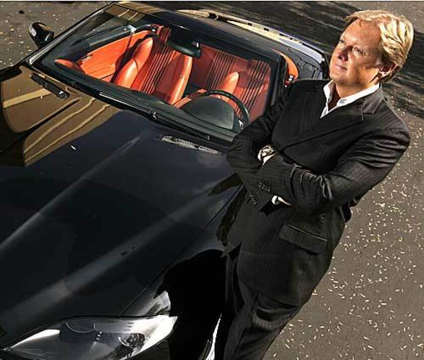 Henrik Fisker, chief executive of Fisker Automotive, poses with one of his most recent creations, the Tramonto.