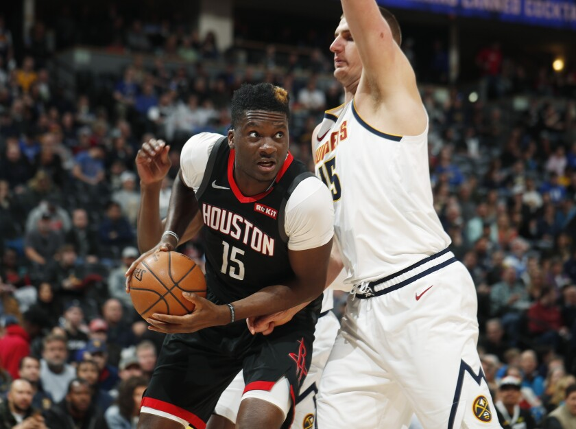 Rockets center Clint Capela drives to the rim against Nuggets center Nikola Jokic during the first half of a game Jan. 26.