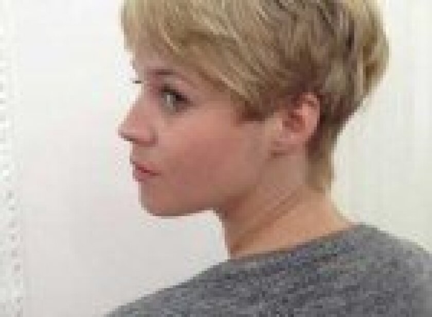 Textured blond style with lovely neckline and flirty fringe in front.
