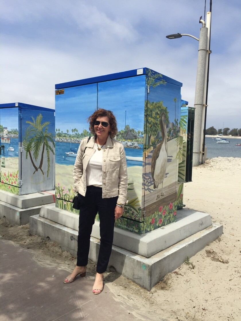 South Mission Beach resident Tina Verburgt paints beach scenes on utility boxes in the community.
