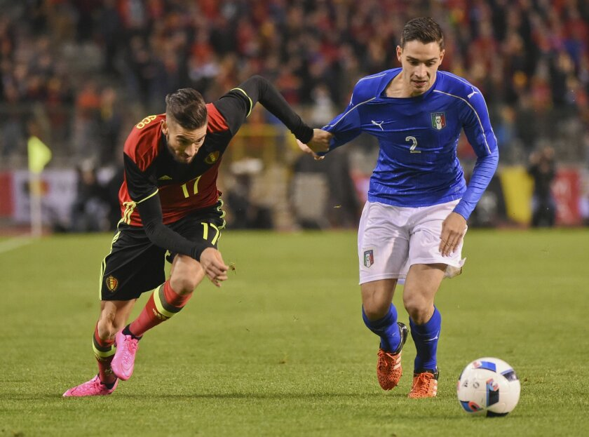 FILE - In this Friday, Nov. 13, 2015 file photo, Belgium's Belgium's Yannick Carrasco, left,  right, fights for the ball with Italy's Mattia De Sciglio during a friendly soccer match at the King Baudouin stadium in Brussels. The European Championship has a reputation for being the soccer fans' favo