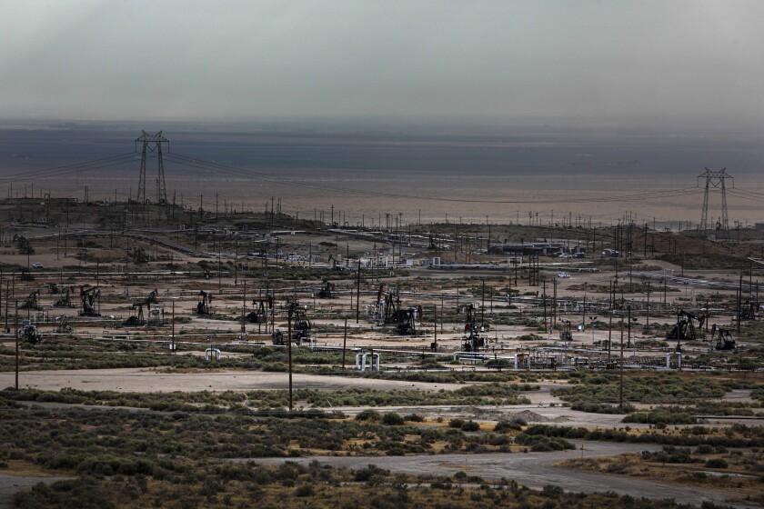 Pump jacks dot the landscape in the Cymric oil field near McKittrick in Kern County
