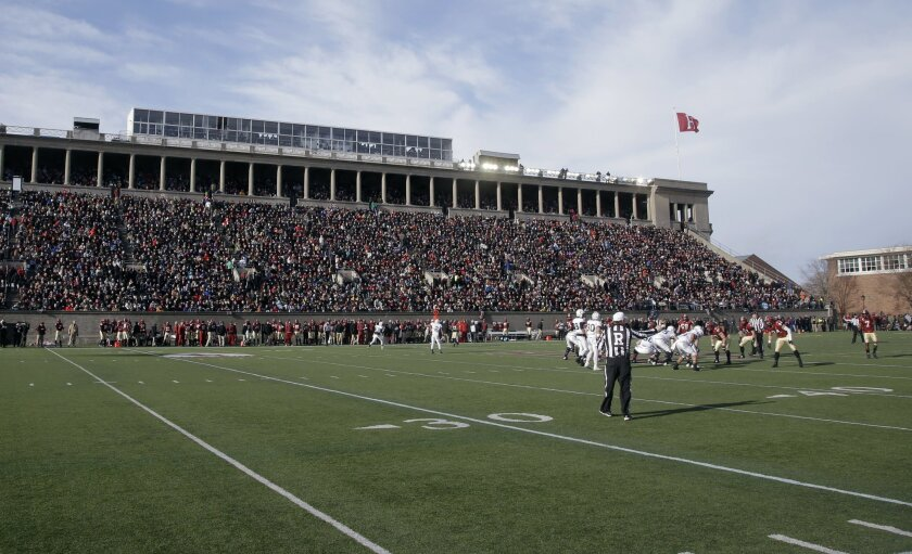In this Nov. 22, 2014 photo, Harvard and Yale football teams compete in Harvard Stadium in Cambridge, Mass. Boston is bidding on the 2024 Summer Olympics, and Harvard Stadium could be used as a venue for field hockey. The crux of the proposal is a walkable, sustainable, technology-based event that