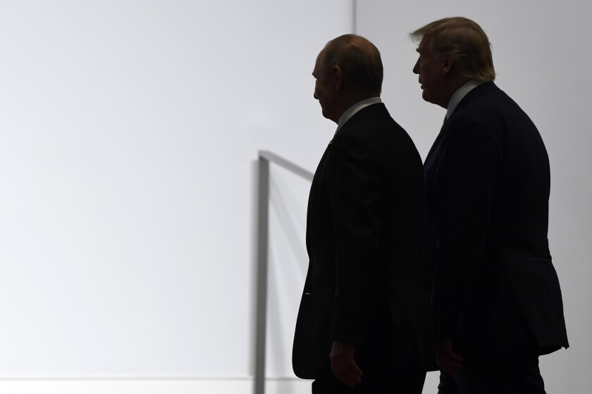 FILE - In this June 28, 2019, file photo President Donald Trump and Russian President Vladimir Putin walk to participate in a group photo at the G20 summit in Osaka, Japan. Most Americans are concerned at least somewhat by the potential for foreign interference in November's election, and a majority believes that Russian sought in 2016 to influence the outcome of that race. (AP Photo/Susan Walsh, File)