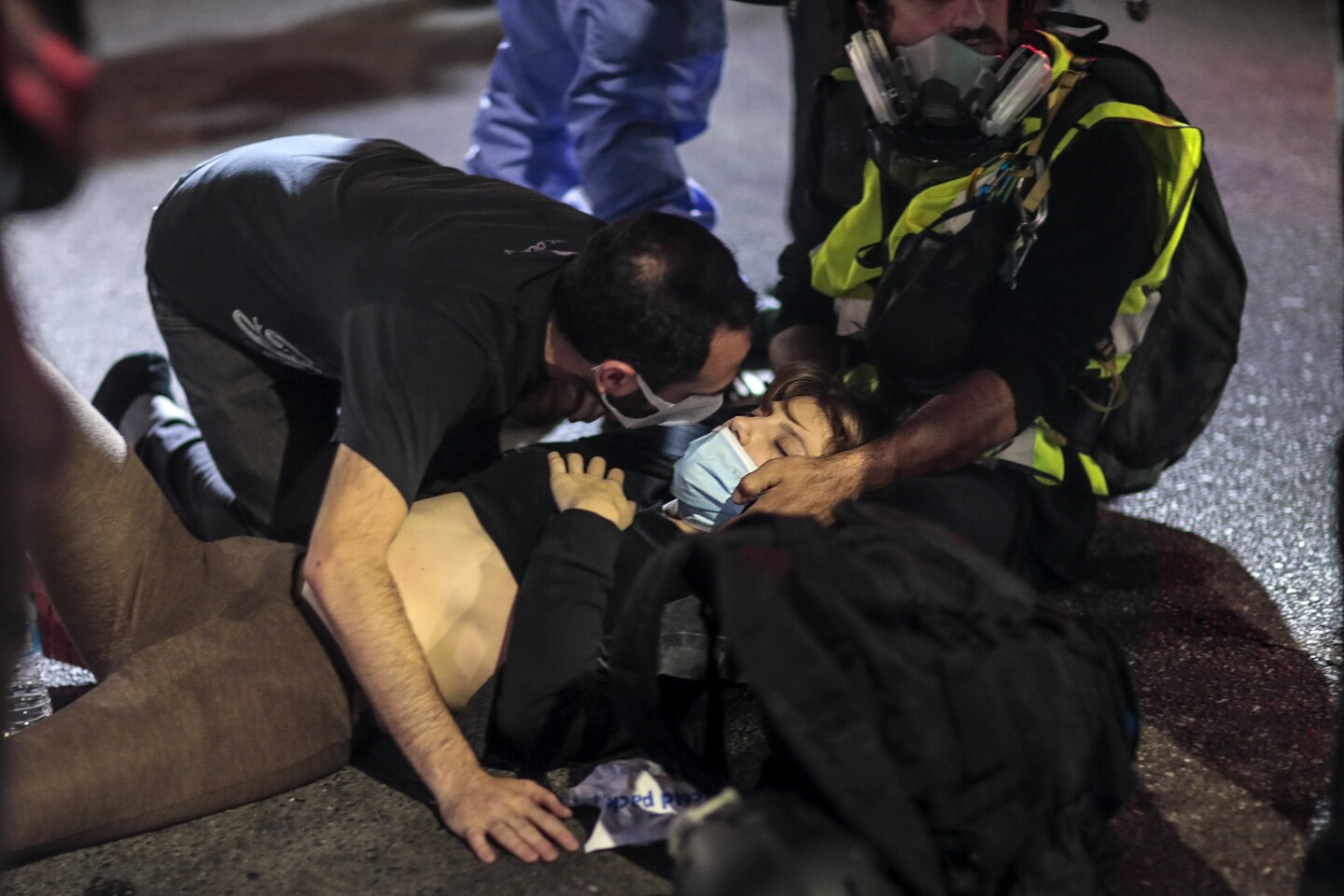 Los Angeles, CA, Thursday, September 24, 2020 - A victim is comforted after being hit by a hit and run driver on Sunset Blvd. as she was protesting the Kentucky grand jury decision in the case of Breonna Taylor's death by Louisville police. (Robert Gauthier/ Los Angeles Times)