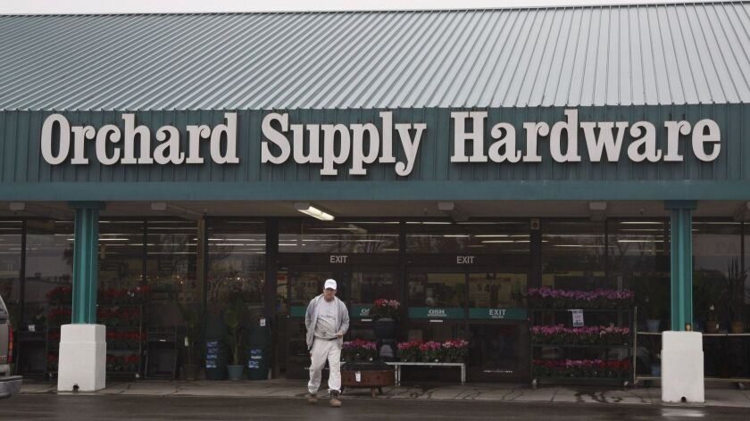 FILE - A customer leaves Orchard Supply Hardware store in Mountain View, Calif., in this Jan. 3, 201