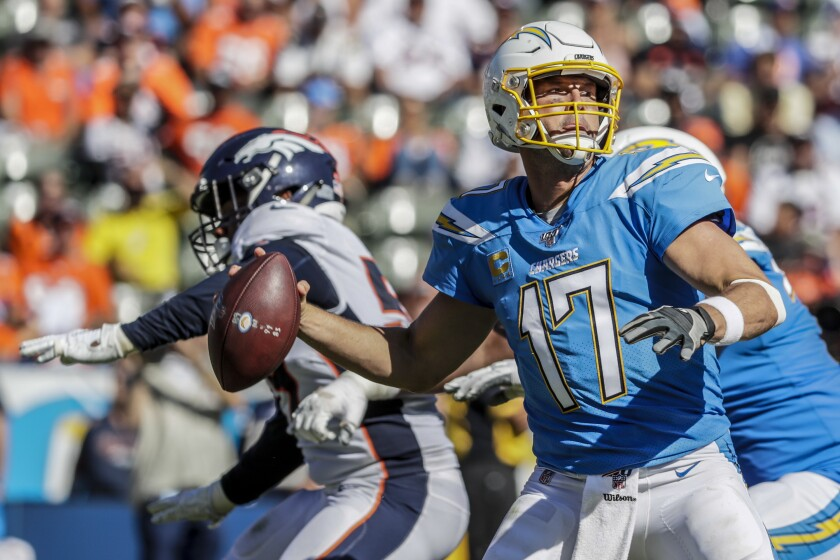 Chargers quarterback Philip Rivers steps up in the pocket to unload a pass against the Broncos on Sunday.