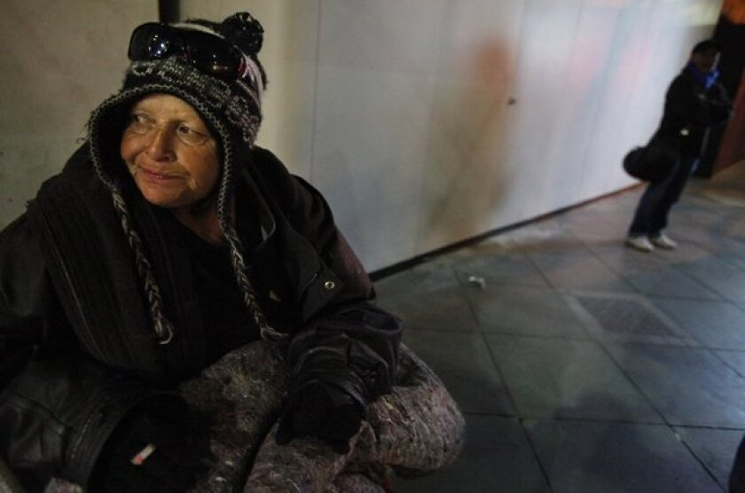 Diane Muldanado, 58, tries to stay warm during the Santa Monica homeless count on Jan. 31, 2013.
