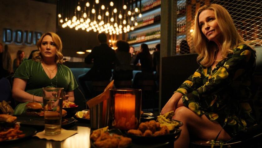 "Emma Hunton, left, and Reagan Pasternak in ""Good Trouble"" on Freeform."