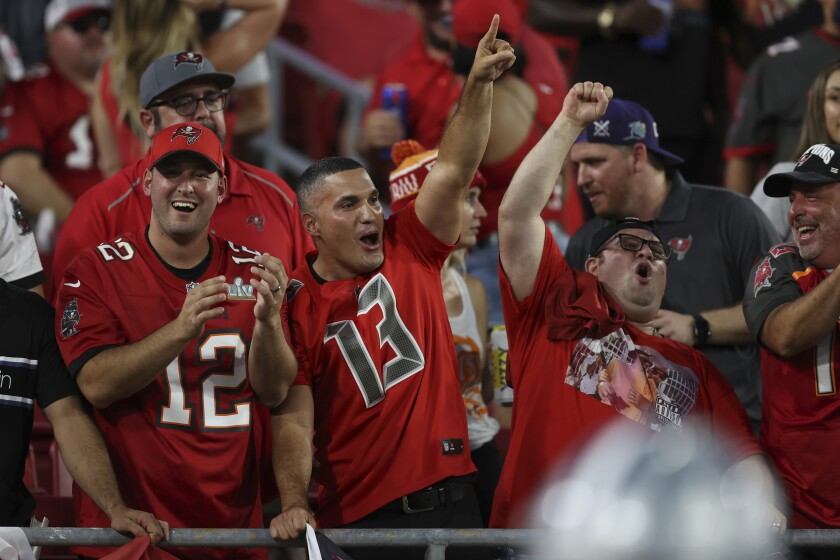 Tampa Bay Buccaneers fans cheer during the first half of Thursday's season opener against the Dallas Cowboys.