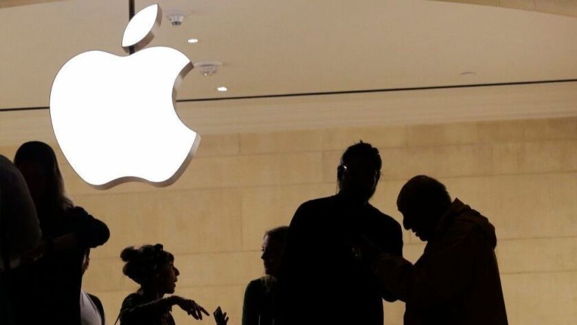 Customers enter an Apple store in New York on May 31, 2018. The Supreme Court is allowing consumers to pursue an antitrust lawsuit that claims Apple has unfairly monopolized the market for the sale of iPhone apps.