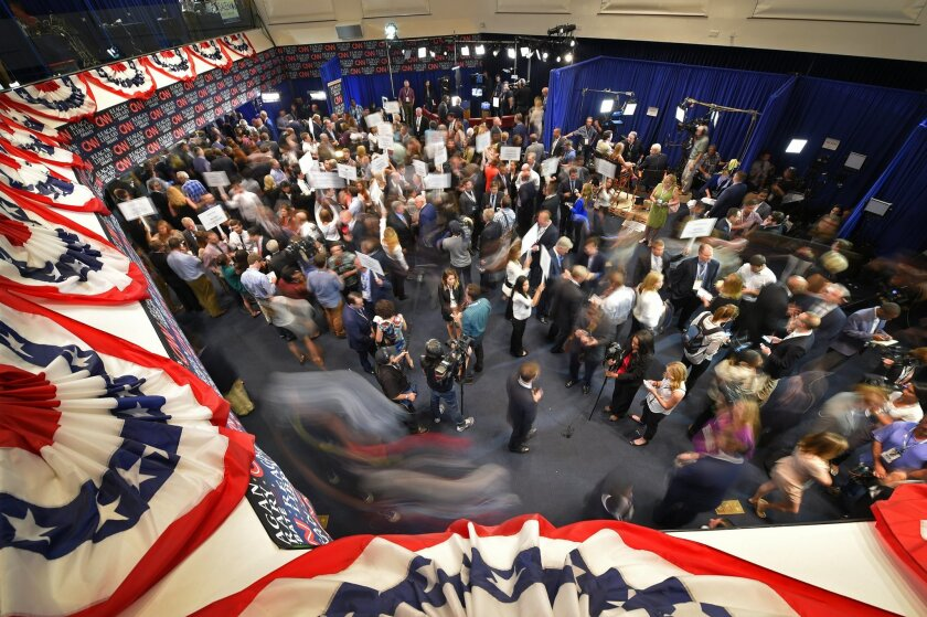 Journalists, candidates and their representatives crowd the spin room following the CNN Republican presidential debate at the Ronald Reagan Presidential Library and Museum on Wednesday, Sept. 16, 2015, in Simi Valley, Calif. (AP Photo/Mark J. Terrill)